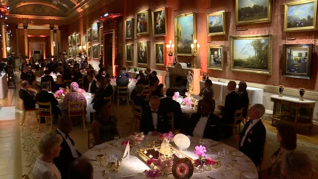 Queen's Dinner Banquet Alternate Angle views of banquet and Queen's speech ENGLAND London Buckingham Palace INT CHOGM Guests into banquet room /...