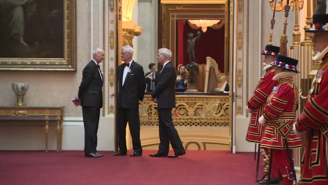 queen's dinner banquet interior arrivals england london buckingham palace int musicians playing / footmen waiting / various arrivals including... - british empire stock videos & royalty-free footage