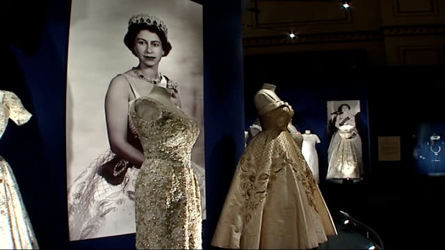 queen's dresses and jewellery in exhibition at buckingham palace england london buckingham palace int full length coat of silver tissue embroidered... - dress stock videos & royalty-free footage