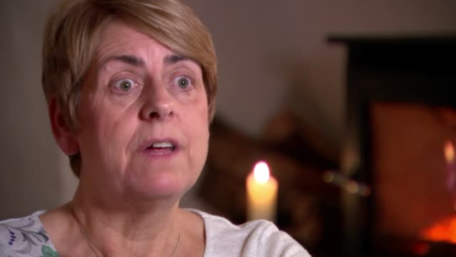 Queen's Gallantry Medal presented to mother of murdered backpacker ENGLAND Sandra Jackson interview SOT Various of Tom Jackson's family Les Jackson...