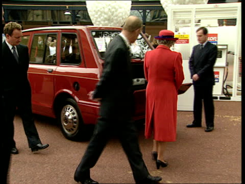 queen's going green itn london buckingham palace queen elizabeth ii and prince philip along and looking at royal cars that have been converted to run... - elizabeth ii stock videos & royalty-free footage