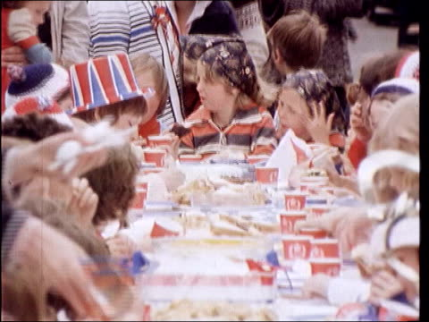 queen's golden jubilee plans lib london edmonton hawthorne way ext 'silver jubilee 1977' sign over door of house decorated in union jack flags street... - street party stock videos and b-roll footage