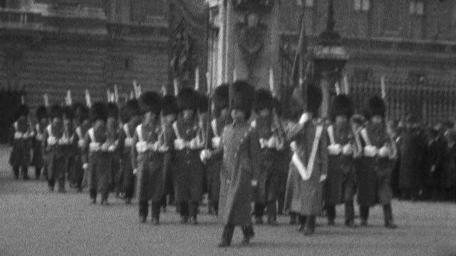 queen's guard with bearskin caps marching from buckingham palace with bayonets people watching in the background - 1925 stock videos & royalty-free footage