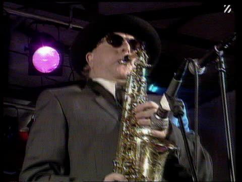 vídeos y material grabado en eventos de stock de queen's honours list includes george martin itn lib int seq van morrison playing saxophone - van morrison