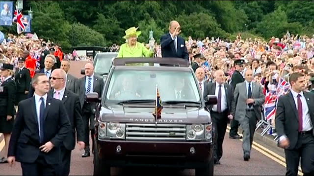 ROYAL / Queen's Jubilee visit to Belfast handshake with Martin McGuinness Stormont PHOTOGRAPHY** Queen and Prince Philip towards in open top car past...