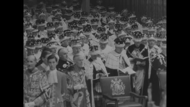 queenõs maids of honor look on / crowd of high officials in audience dressed in traditional costumes and wearing crowns look on / maids of honor pan... - coronation of queen elizabeth ii stock videos and b-roll footage