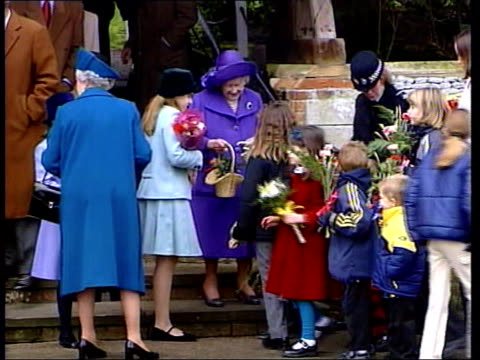 Queen's message Royals at Sandringham UK POOL Children giving flowers to Queen and Queen Mother after church service Prince Charles Princess Anne and...