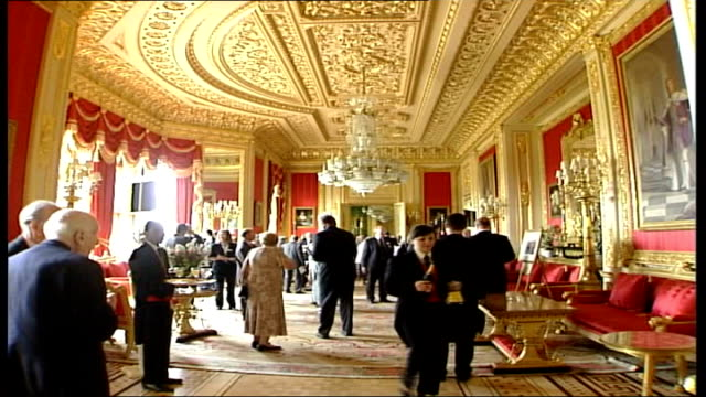 queen's residences in need of repair england berkshire windsor windsor castle int general views of guests mingling at a reception to mark the 150th... - the victoria cross stock-videos und b-roll-filmmaterial