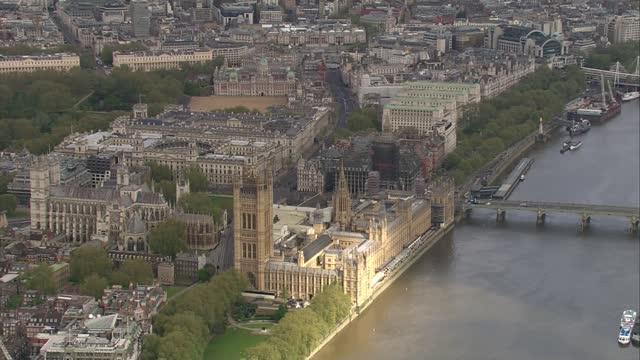 aerials of prince charles' and the queen's journeys to parliament; england: london: ext air view central london, the river thames, bridges, the... - politics stock videos & royalty-free footage