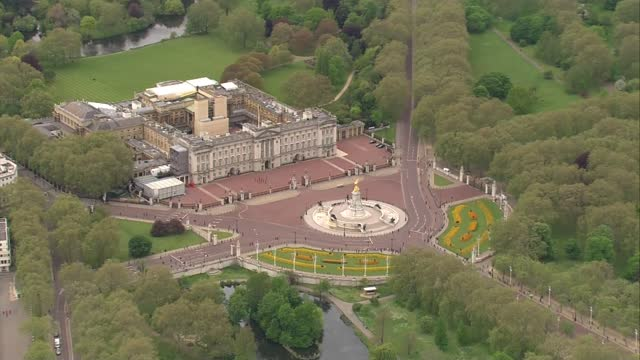 aerials of prince charles' and the queen's journeys to parliament; england: london: ext air view car carrying prince charles, prince of wales and... - politics stock videos & royalty-free footage