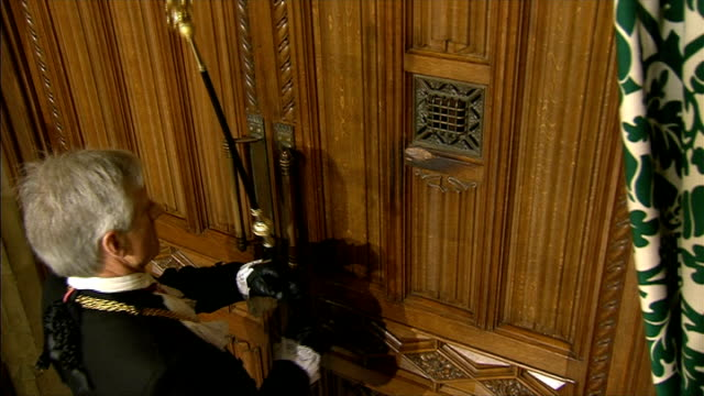 queen's speech black rod summons mps england london westminster int doors to house of commons slam shut / black rod banging on doors and doors opened... - rod stock videos & royalty-free footage