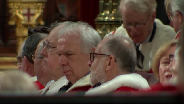 queen's speech conservative mps row over content close shot of royal crest in lord's lobby peers seated in lords chamber lords' chamber seen through... - the queen's speech state opening of uk parliament stock videos & royalty-free footage