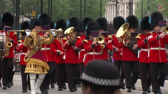 queen's speech conservative mps row over content cutaway ext military band marching and playing natsot - the queen's speech state opening of uk parliament stock-videos und b-roll-filmmaterial