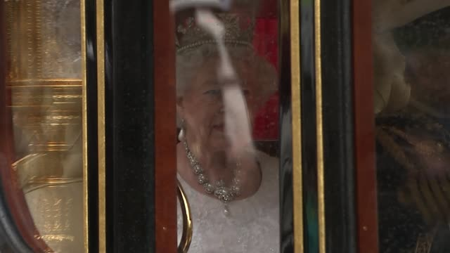 queen's speech conservative mps row over content england london westminster ext queen elizabeth ii waving from carriage as along to parliament... - the queen's speech state opening of uk parliament stock videos & royalty-free footage