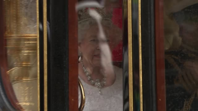 queen's speech conservative mps row over content england london westminster ext queen elizabeth ii and prince philip the duke of edinburgh along in... - the queen's speech state opening of uk parliament stock-videos und b-roll-filmmaterial