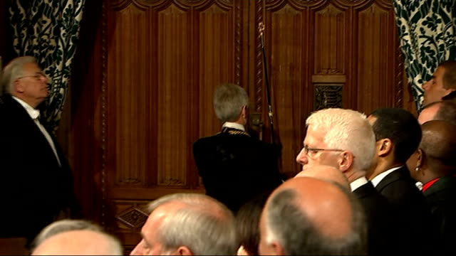 interior lobby shots; bercow and black rod along / mps standing around waiting in lobby / black rod announced, knocking on door to house of commons... - mp stock-videos und b-roll-filmmaterial