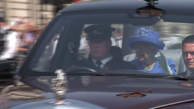 queen's speech main england london westminster ext queen elizabeth in car with prince charles prince of wales as through parliament square and and... - the queen's speech state opening of uk parliament stock-videos und b-roll-filmmaterial