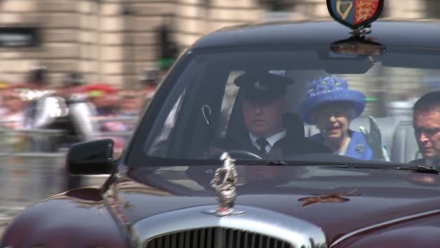 queen's speech main england london westminster ext queen elizabeth in car with prince charles prince of wales as through parliament square and and... - the queen's speech state opening of uk parliament stock videos & royalty-free footage