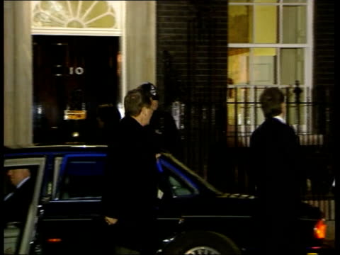 london: downing street: ext at night car carrying prime minister tony blair mp pulling up outside number 10 and blair out westminster: day carriage... - 年次イベント点の映像素材/bロール