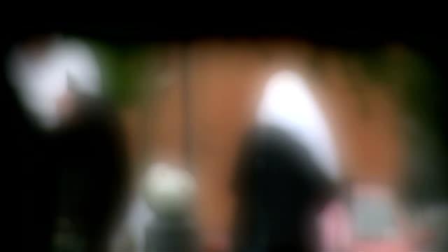 queen's speech / row over birmingham schools; t02061413 / tx 2.6.2014 birmingham: soft focus shots of children leaving school in birmingham - soft focus stock videos & royalty-free footage