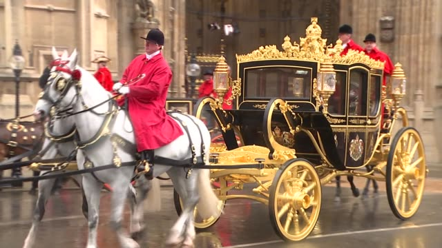 queen's speech royal coaches depart england london westminster ext household cavalry along past houses of parliament / royal coach departs from... - the queen's speech state opening of uk parliament stock videos & royalty-free footage