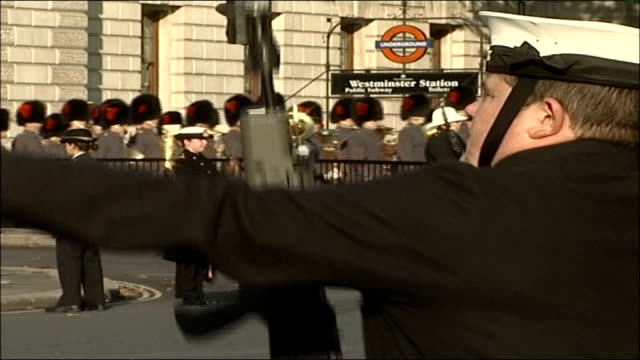 queen's speech; westminster: ext coldstream guards marching along with soldier and bayonet in the foreground - bayonet stock videos & royalty-free footage
