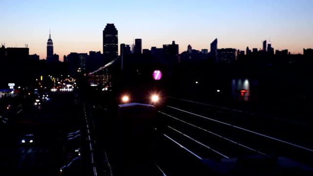 queens subway 7 train at dusk - underground train stock videos & royalty-free footage