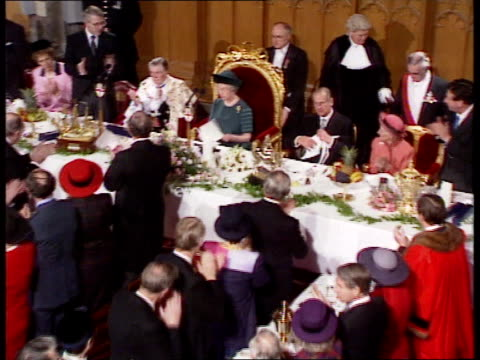 queen's 'sympathy' speech at london guildhall itn tms queen sitting down after speech pull out cms john major pm chatting to queen at table pull out - john major stock videos & royalty-free footage