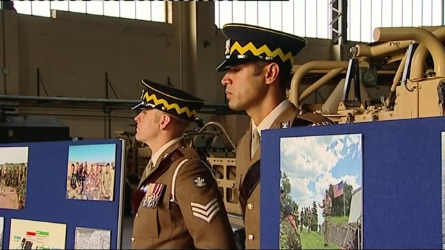 queens visits royal scots dragoon guards queen talking and listening to soldiers / soldiers in tank / soldier along on horse / close shot medals... - silver platter stock videos and b-roll footage