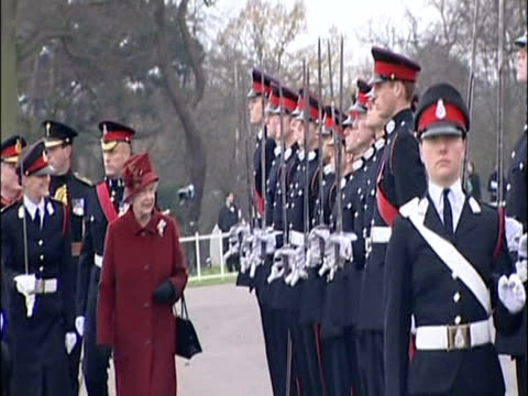 Queens walks along line up of recruits including Prince William at Sandhurst academy