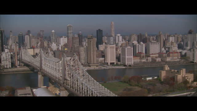 low aerial, queensboro bridge and city skyline, new york city, new york, usa - letterbox format stock videos & royalty-free footage
