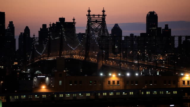 queensboro bridge at dusk in new york city - queens new york city stock videos and b-roll footage