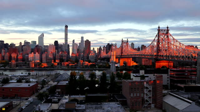 queensboro bridge during sunrise - queens new york city stock videos and b-roll footage