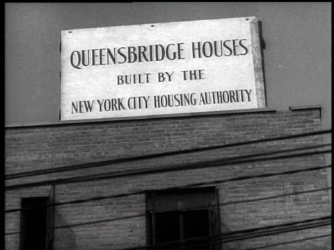 1939 ws queensbridge housing project sign / new york city, new york, usa - 公営アパート点の映像素材/bロール