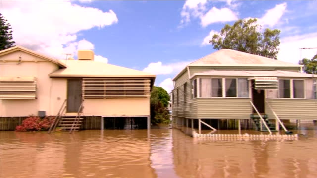 waters peak in town of Rockhampton AUSTRALIA Queensland Rockhampton SHOTS from moving boat as along through flooded town past stilt houses and...