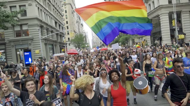 queer women and dykeidentified trans and nonbinary folks marched down fifth avenue for the 26th annual dyke march in new york city #nycdykemarch as... - marciare video stock e b–roll