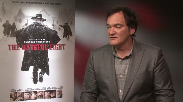 quentin tarantino interview; england: london: int quentin tarantino interview sot - on his films being events / brian de palma and stanley kubrick... - brian wells stock videos & royalty-free footage