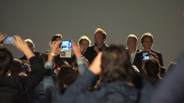 Quentin Tarantino John Travolta Uma Thurman present 'Pulp Fiction' Beach Screening on May 23 2014 in Cannes France