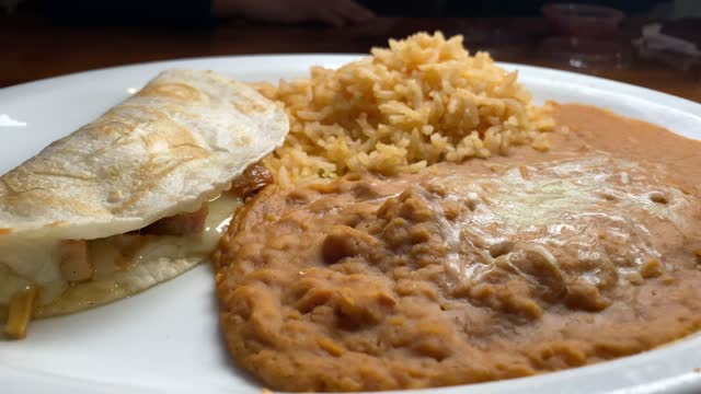 quesadilla and refried beans on a plate - bean stock videos & royalty-free footage