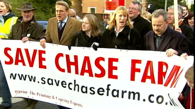 vídeos y material grabado en eventos de stock de questions over reliability of new nhs 'friends and family test' t03120536 / tx ext protesters against closures at chase farm hospital marching with... - placard