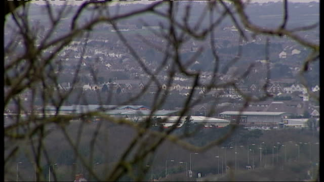 questions over strategies to deal with teenage suicides bridgend ext general views of town and countryside - 自殺点の映像素材/bロール