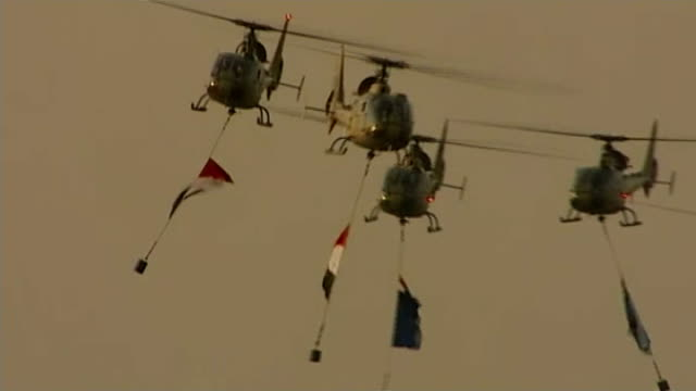 Questions raised about whether Al Jazeera did enough to protect staff in Egypt LIB / TX Helicopters along with Egyptian flags hanging below END LIB