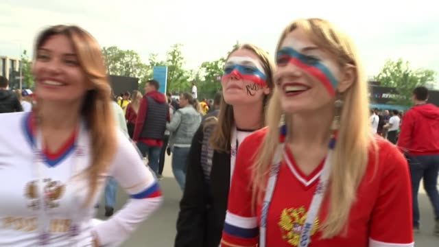 questions raised on reality of russia's new world cup image russia ext vox pops russian fan in headgear sot*** fans along woman taking photograph of... - women politics stock videos & royalty-free footage