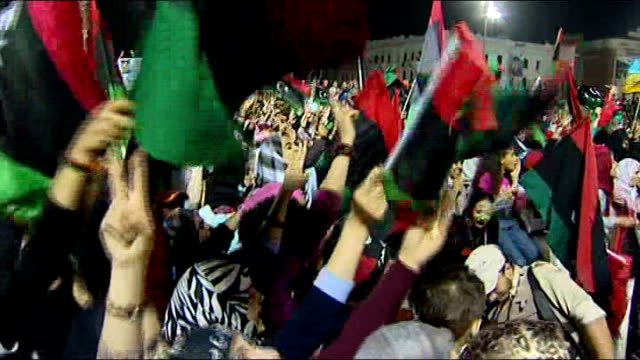 questions remain over deaths of gaddafi and his son mutassim and about the fate of his son saif men waving rifles in the air crowd waving new libyan... - muammar gaddafi stock videos & royalty-free footage