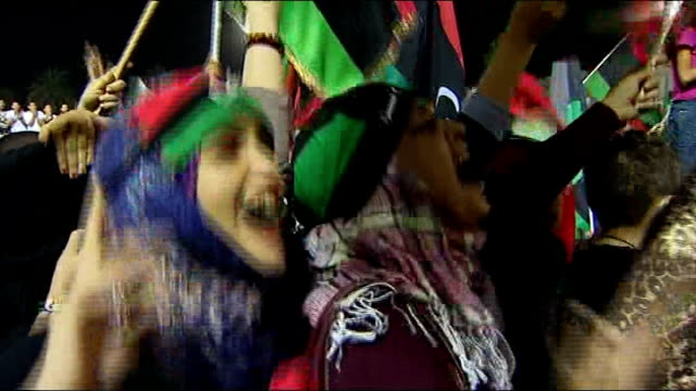 vídeos de stock, filmes e b-roll de questions remain over deaths of gaddafi and his son mutassim and about the fate of his son saif women celebrating - arab spring