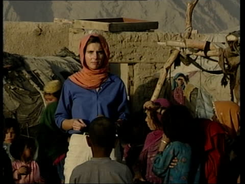 i/c Afghan children in refugee camp NIGHT Hugh Colville interviewed SOT Taking a risk food agencies are sending aid in a way they wouldn't normally...