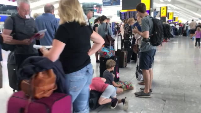 queue of holiday makers at heathrow airport after computer problems with british airways check in system led to flight cancellations - tourism stock videos & royalty-free footage