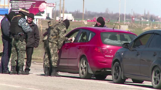 a queue of motorists patiently await their turn in the northern village of chongar in crimea which now serves as a checkpoint at the russian ukranian... - sevastopol crimea stock videos and b-roll footage