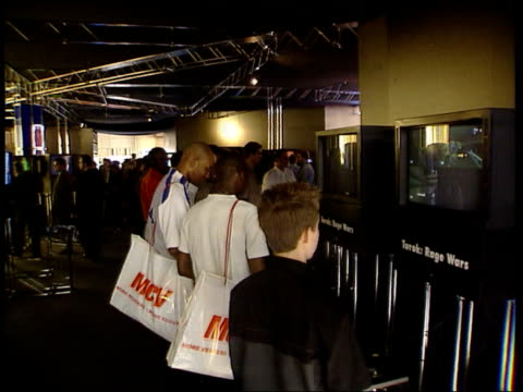 retail / queues for new playstation lib london olympia people looking at screens showing playstation at exhibition gv bank of screens showing sony... - sony stock videos & royalty-free footage