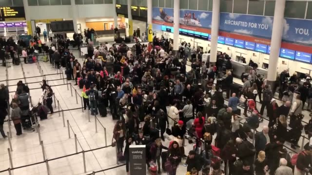 queues form at gatwick airport on thursday, december 20, after drones force flight cancellations and runway closures. - gatwick airport stock videos & royalty-free footage